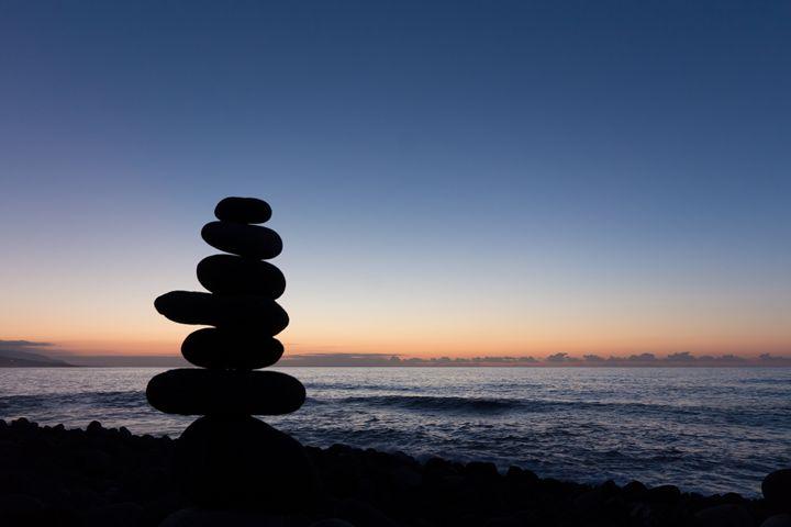 Beach sunset with stone pyramid - hanoh iki