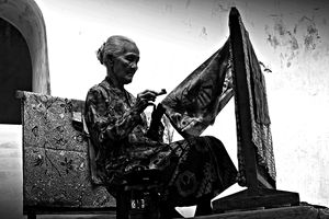 an elderly woman making traditional