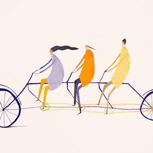 Three people cycling