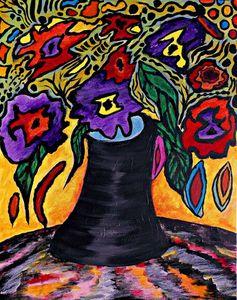 Black vase with flowers