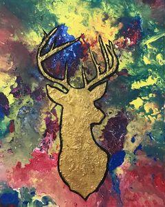 Golden deer in colorful background