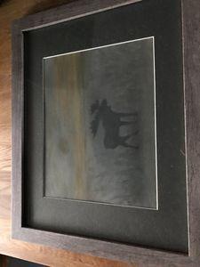 Pastel moose in the woods framed