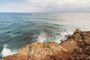 Waves crashing to rock