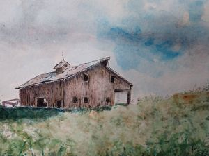 Weathered barn in Iowa on stormy day
