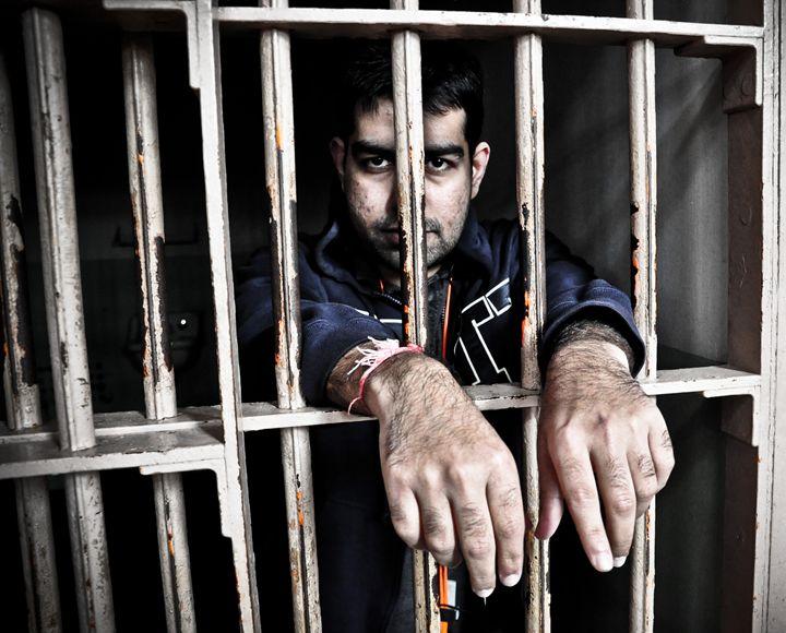 Prisoner behind bars - Capturing Life