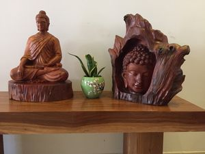 Wooden Buddha head from the tree log