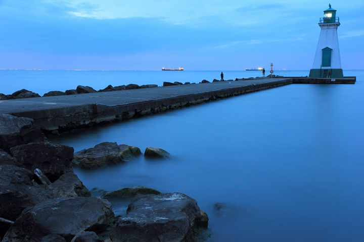 Rocks Lighthouse and Pier in Blue - Donny R. Coutu