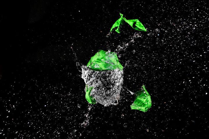 Green Balloon pops into pieces - Sotiriadis Giannis