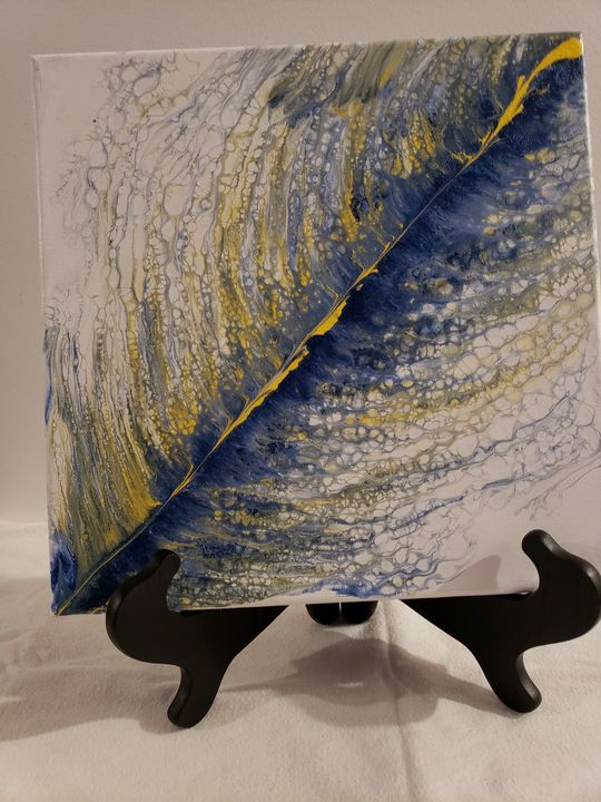 blue and yellow feather - The Pour Ladies