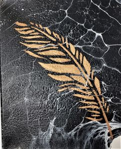 Feather on Marble