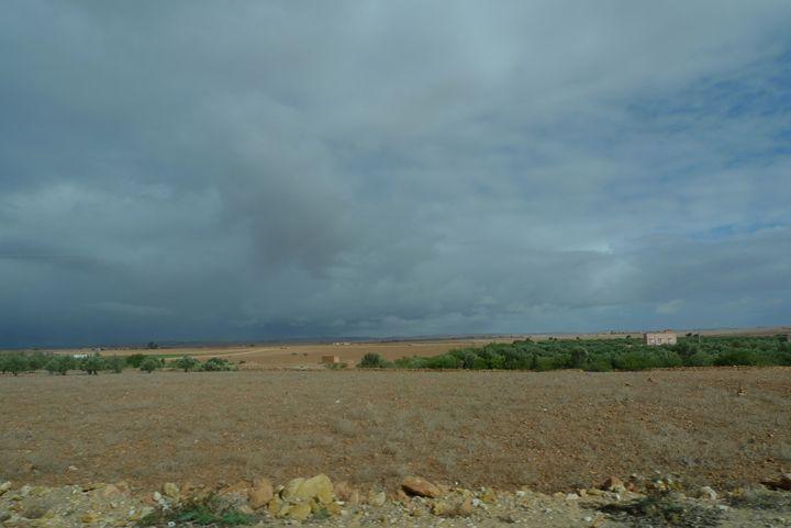 Storm brewing over the Saraha 3 - John Brooks Art & Photography