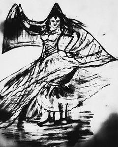 A lady playing dandia an Gujarati da