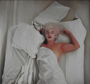 Marilyn Monroe beneath white sheets