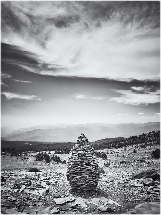 Pineal stone stack on mountain - Edward Maesen