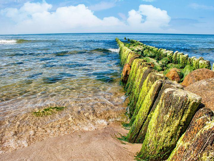 sea waves break on the breakwater - Radomir