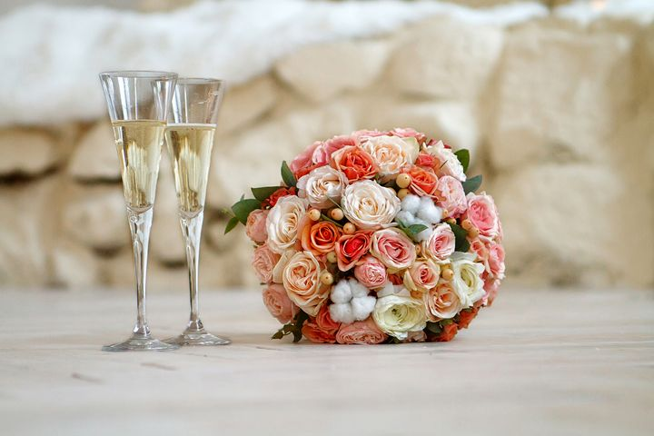 bridal bouquet and two glasses of ch - Radomir