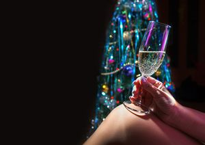 female hand holding champagne glass