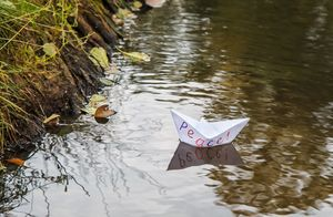 lonely white paper boat called peace