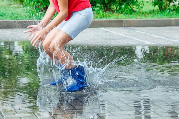 girl in rubber boots jumping in a pu - Radomir