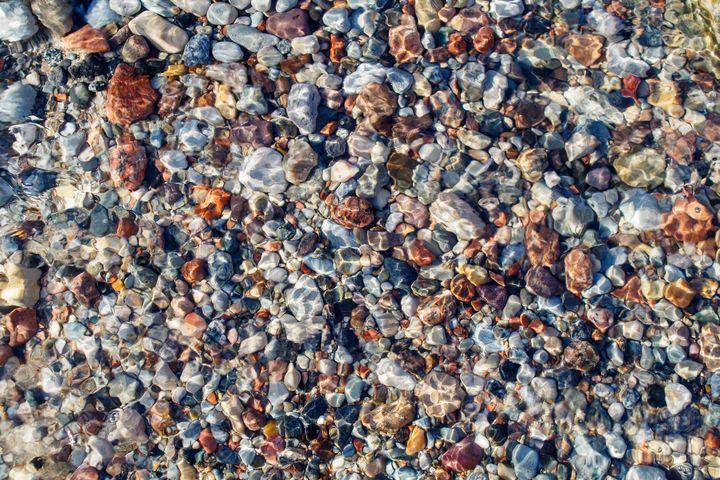 small multicolored stones under wate - Radomir