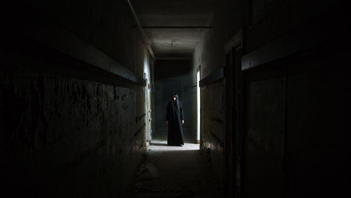 gothic brunette woman standing in lo - Radomir