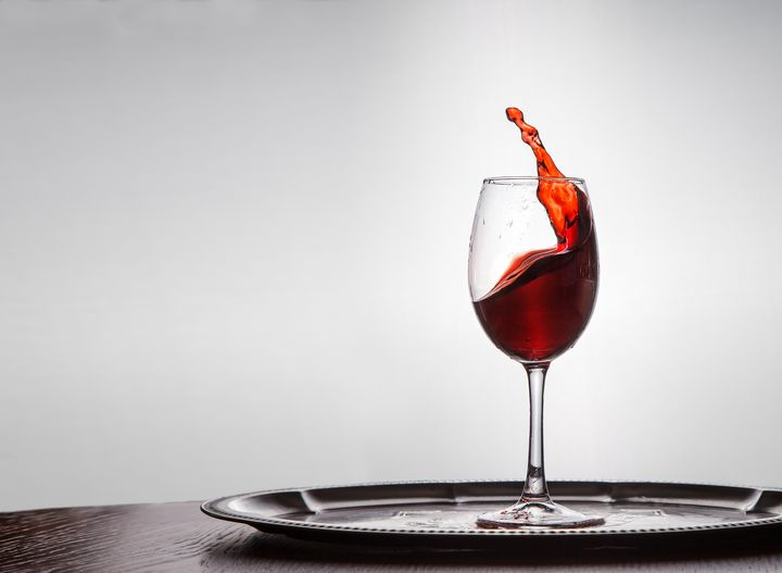 red wine spills out of a glass - Radomir