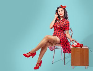 happy young pinup woman sitting on a