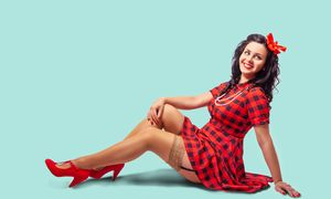 young pinup woman sitting on the flo