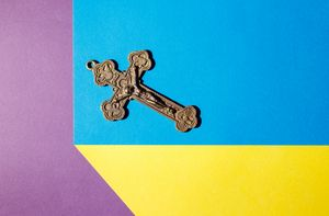 bronze cross on the colored table