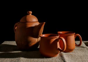 still life with a clay teapot and tw