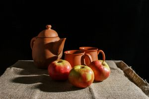 still life with a clay teapot, cups