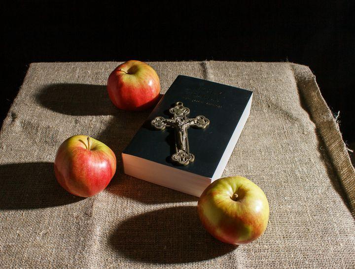 bronze cross, holy bible and three a - Radomir