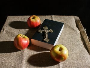 bronze cross, holy bible and three a