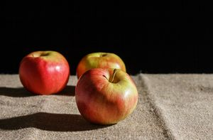 three apples on the table