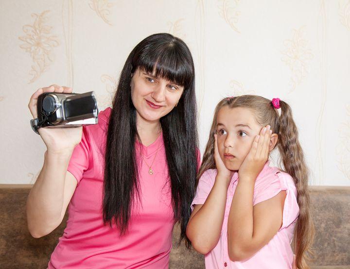 mom showing her little daughter wher - Radomir