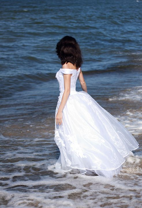young girl in white dress on the sea - Radomir