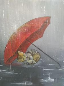 Kitten under red umbrella
