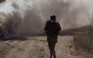 A soldier ran through thick smoke
