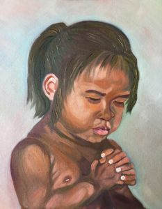 An infant is pray for a better Noel