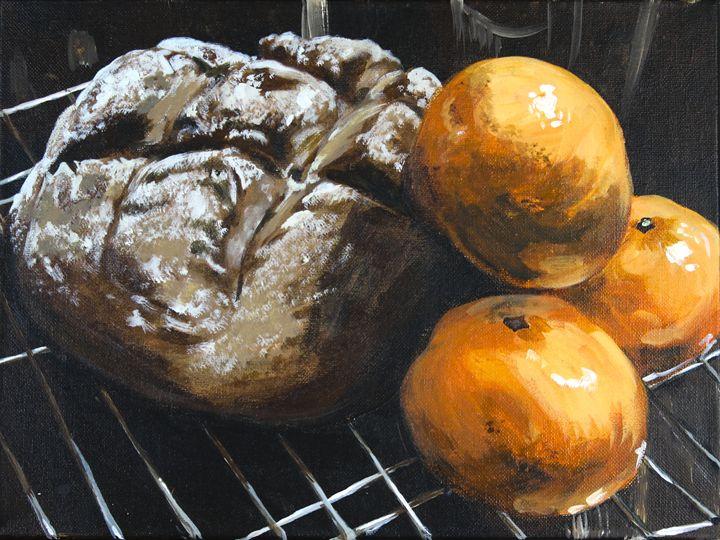 fresh bread and tangerine still life - alyssa brown