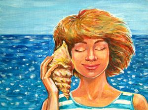 A girl listens to a seashell