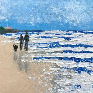 Couple with Dog on the Beach