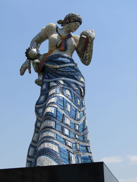 African woman carrying baby - African Art