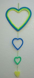blue, green and yellow heart