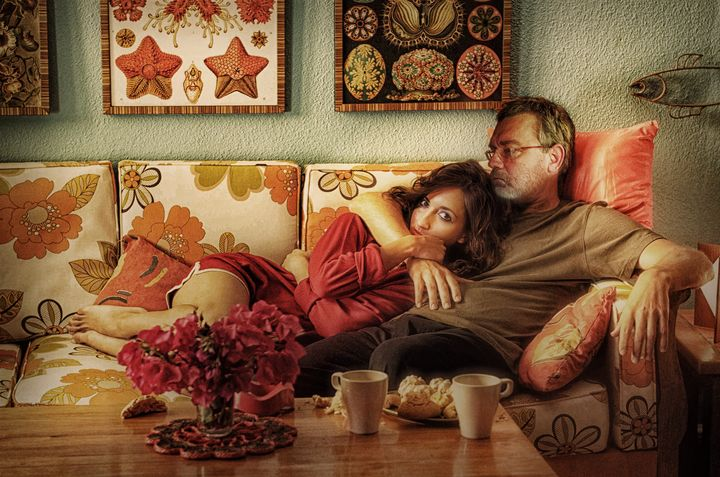 Jimmy and Jessica Curled Up On Couch - Jimmy Andrews