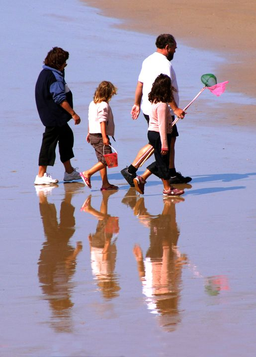 A family on the beach at Westward Ho - Rod Jones Photography