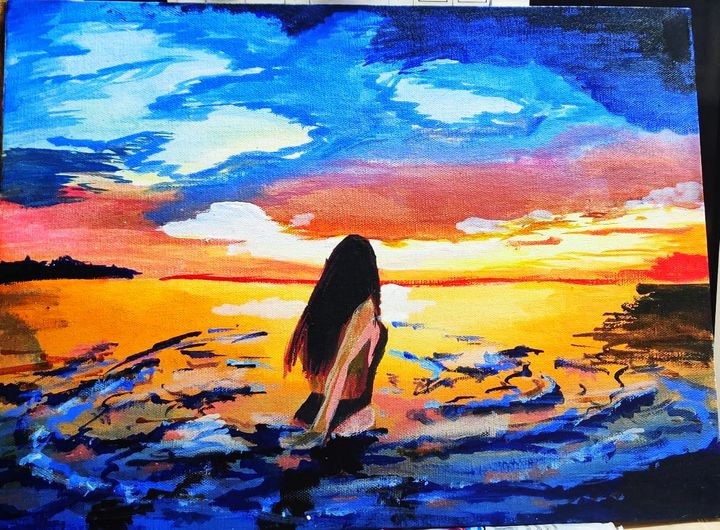A girl on a beach enjoying the sunse - The Brilliant Brushes✨