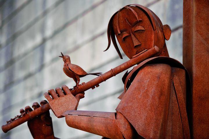 Man Playing a Flute - Charel Schreuder Photography