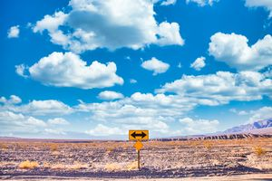 Directional sign in the desert