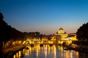 Sunset on Tiber river bridge, Rome